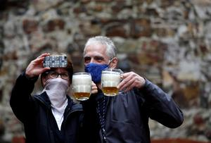 Cheers: People take a selfie at an outdoor seating section of a Prague pub, as the Czech government lifted restrictions allowing restaurants with outdoor areas to reopen. Photo: REUTERS/David W Cerny