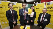 28/02/2020 Minister for Health, Simon Harris and from left, Dr. Ronan Glynn, Deputy Chief Medical Officer, HSE, Dr. Sarah Doyle, HSE Consultant in Public Health and Paul Reid, Director General of the HSE speaks to staff at the Coronavirus/COVID-19 advice stand at the arrivals baggage claim hall in Dublin Airport pictured this afternoon...Picture Colin Keegan, Collins Dublin