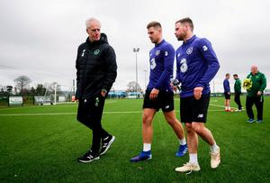 Mick McCarthy talks to James Collins and Alan Judge in training last March. Photo: Stephen McCarthy/Sportsfile