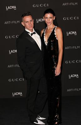 Designer Jeremy Scott (L) and model Liberty Ross attend the 2014 LACMA Art + Film Gala honoring Barbara Kruger and Quentin Tarantino presented by Gucci at LACMA