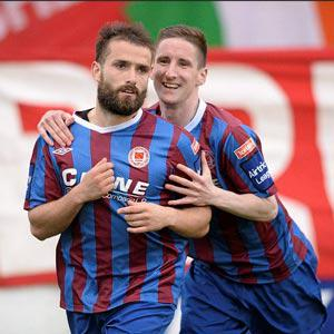 Christy Fagan, left, St. Patrick's Athletic, celebrates with team-mate Ian Bermingham after scoring his side's first goal, Shelbourne