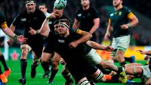 New Zealand 's Sam Cane wins the ball under pressure from Damian De Allende