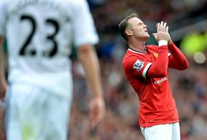 Wayne Rooney shows his frustration during Manchester United's opening day defeat to Swansea City at Old Trafford. Photo: Martin Rickett/PA Wire