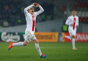 Poland's Sebastian Mila (L) celebrates after scoring a goal during the Euro 2016 Group D qualifying soccer match against Georgia in Tbilisi