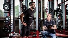 Noel Doherty examines Ireland and Munster rugby star Conor Murray using the Hamstring Solo machine. Photo: Cathal Noonan