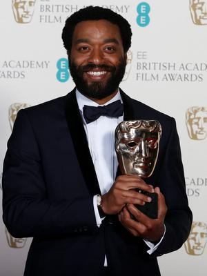 """Actor Chiwetel Ejiofor celebrates after winning Best Actor for """"12 Years a Slave"""""""