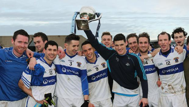 Diarmuid Connolly lifts the Dublin AFL Division 1 Cup, surrounded by his St Vincent's team-mates