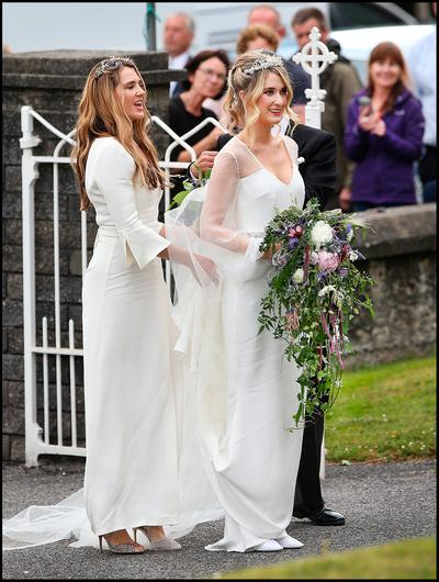 The bride Camilla Campion-Awwad arriving with her sister Aysha Campion-Awwad who was a bridesmaid at the Sacred Heart Chuch in Glengarriff where the wedding  took place. Photo: Steve Humphreys