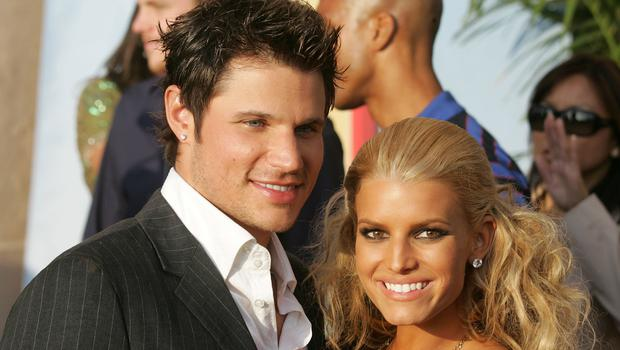 Jessica Simpson (R) and Nick Lachey arrive to the 2005 MTV Movie Awards at the Shrine Auditorium June 4, 2005 in Los Angeles, California