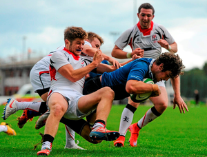 Leinster captain Caelan Doris, goes through the tackles of Ulster's Ben Finlay and Jonathon Stewart as he scores his team's second try in their 12-9 victory in the U18 Schools Interprovincial Championship