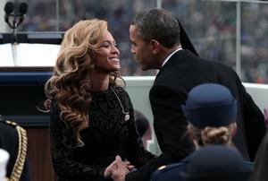 President Barack Obama greets singer Beyonce after she performs the National Anthem during the public ceremonial inauguration following his re-election.
