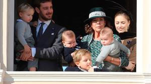 Princess Caroline of Hanover (3rdR), her son Pierre Casiraghi (2ndL) with his wife Beatrice Borromeo and son Stefano (L) appear on the balcony of the Monaco Palace during celebrations marking Monaco's National Day in Monaco on November 19, 2018. (Photo by VALERY HACHE / AFP)