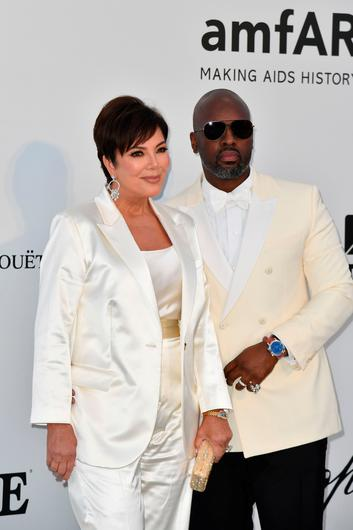 US entrepreneur Kris Jenner (L) and her partner Corey Gamble pose as they arrive on May 23, 2019 at the amfAR 26th Annual Cinema Against AIDS gala at the Hotel du Cap-Eden-Roc in Cap d'Antibes, southern France, on the sidelines of the 72nd Cannes Film Festival. (Photo by Alberto PIZZOLI / AFP)