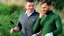 KINGSBARNS, SCOTLAND - OCTOBER 03:  Jamie Dornan the film actor with Brian O'Driscoll the Irish International Rugby player on the 12th hole during the third round of the 2015 Alfred Dunhill Links Championship at Kingsbarns on October 3, 2015 in Kingsbarns, Scotland.  (Photo by David Cannon/Getty Images)