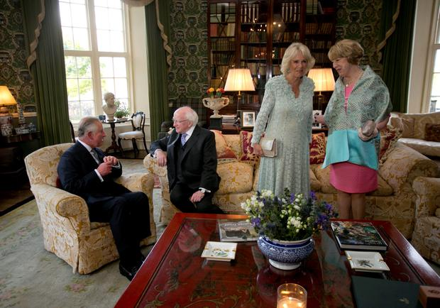 (Left - right) The Prince of Wales and President Michael D Higgins with the Duchess of Cornwall and Sabina Higgins at Lough Cutra Castle, Galway, on the first day of the Royal visit to the Republic of Ireland. PRESS ASSOCIATION Photo. Picture date: Tuesday May 19, 2015. See PA story ROYAL Ireland. Photo credit should read: Chris Bellew/Fennell Photography/PA Wire