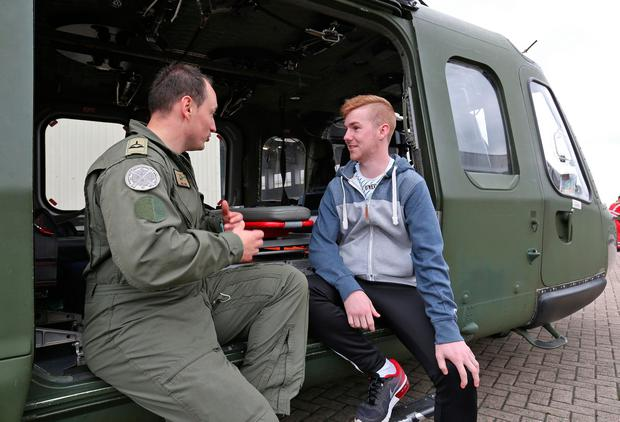 Lee Keely from Wexford with Airman Jamie O'Sullivan who was one of the crew members who saved his life aboard the Aer Corps Augusta AW139 helicopter after a car accident. Photo: Collins