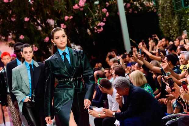 US model Gigi Hadid presents a creation for fashion house Versace during the presentation of its women's and men's spring/summer 2020 fashion collection in Milan on June 15, 2019. (Photo by Miguel MEDINA / AFP)