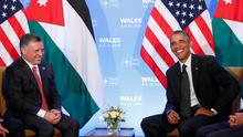 U.S. President Barack Obama (R) and Jordan's King Abdullah II smile during a meeting at the NATO Summit at the Celtic Manor Resort in Newport, Wales, September 4, 2014