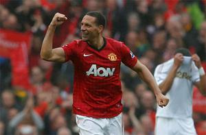 Manchester United's Rio Ferdinand celebrates his game-winning goal against Swansea City