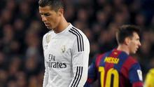 "Barcelona's Lionel Messi (R) and Real Madrid's Cristiano Ronaldo react during their Spanish first division ""Clasico"" soccer match at Camp Nou"