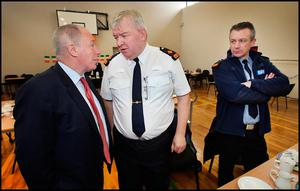 Minister of State for Regional Economic Development Michael Ring chats with Garda Supt. Tony Healy from Belmullet Garda Station and Garda Inspector Garry Walsh (right)  after he paid a visit to Aughleam Community Hall near Blacksod in Co Mayo during the seach and recovery of Rescue 116. Pic Steve Humphreys