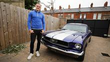 Gearing up: Rugby player Jacob Stockdale at his east Belfast home with his prized Mustang. Photo: Kelvin Boyes/Press Eye