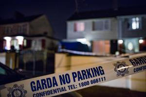 Gardai investigate the fatal stabbing of a man at a house on Harmonstown Road. Photo: Arthur Carron