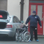 Caught on camera: Constantin Iosca is filmed in his wheelchair and walking putting the wheelchair in a car despite his alleged injuries.