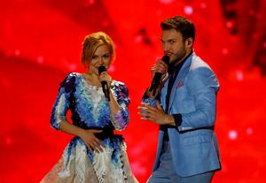 """Singer Monika Linkyte and Vaidas Baumila representing Lithuania performs the song """"This Time"""" during the second semifinal of the upcoming 60th annual Eurovision Song Contest In Vienna, May 21, 2015. REUTERS/Leonhard Foeger"""