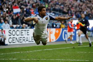 France's Wesley Fofana jumps to score a try against Italy