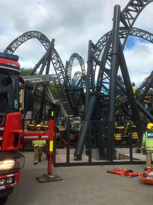 BEST QUALITY AVAILABLE  Handout photo taken with permission from the Twitter feed of @OFFICIALWMAS of the scene at Alton Towers as four teenagers have suffered serious leg injuries in a collision between two carriages on the amusement park's Smiler rollercoaster. PRESS ASSOCIATION Photo. Issue date: Tuesday June 2, 2015. The accident, at around 2.09pm, involved a moving carriage with 16 passengers and an empty, stationary carriage which came together on a low section of the track. A West Midlands Ambulance Service spokeswoman said that four teenagers - two males and two females - were seriously injured in the crash, while the other 12 occupants required triage. The £18 million rollercoaster, which boasts a world record-breaking 14 loops, has been closed on two occasions because of safety concerns since opening two years ago. Visitors to Alton Towers reported on social media that the ride had broken down earlier today. See PA story ACCIDENT AltonTowers. Photo credit should read: West Midlands Ambulance Service/PA Wire  NOTE TO EDITORS: This handout photo may only be used in for editorial reporting purposes for the contemporaneous illustration of events, things or the people in the image or facts mentioned in the caption. Reuse of the picture may require further permission from the copyright holder.
