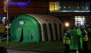 A medical tent outside the Odyssey Arena in Belfast, as up to 60 young people attending at concert there became ill. Thursday February 6, 2014. A number of people have been taken to hospitals across Belfast to be treated for the effects of drugs and alcohol. They had been attending a dance event headlined by Dutch DJ Hardwell. Paul Faith/PA Wire
