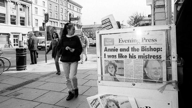 People walk past a newspaper stand with the 'Evening Press' headlines about Bishop Eamonn Casey and Annie Murphy's affair, in June 1992. Photo: RollingNews.ie
