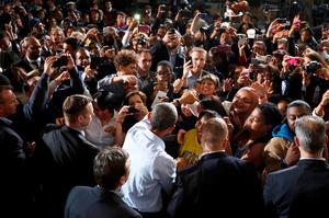 U.S. President Barack Obama greets supporters after rallying for U.S. Representative Gary Peters (D-MI), candidate for U.S. Senate, and former U.S. Representative Mark Schauer (D-MI), candidate for governor of Michigan, at Wayne State University in Detroit, Michigan November 1, 2014.