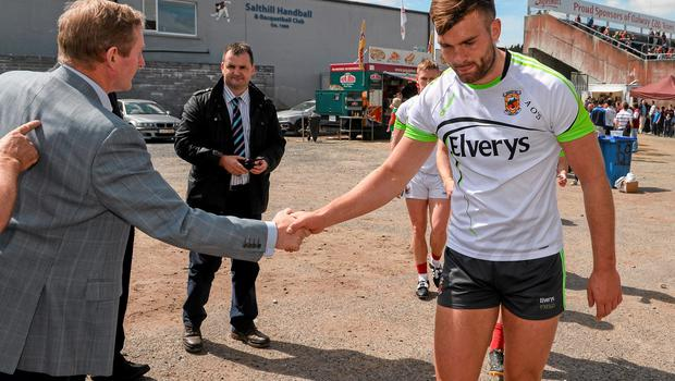 14 June 2015; An Taoiseach Enda Kenny, shakes hands with fellow Mayoman Aidan O'Shea, as the team walk back to their dressing room after their warm up. Connacht GAA Football Senior Championship Semi-Final, Galway v Mayo. Pearse Stadium, Galway. Picture credit: David Maher / SPORTSFILE