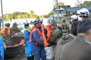 Rescue workers help residents evacuate an area after Typhoon Hagibis swept through Kawagoe  JGSDF via REUTERS