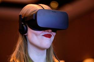 Meghan Puhr participates in a virtual realty presentation during an Intel news conference before CES International, Wednesday, Jan. 4, 2017, in Las Vegas. (AP Photo/John Locher)