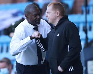 Kilmarnock boss Alex Dyer and his Celtic counterpart Neil Lennon exchange pleasantries at the end of yesterday's draw at Rugby Rark. Photo: Reuters