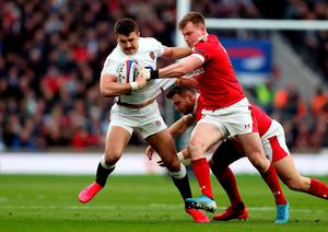 England Henry Slade is tackled by Wales' Nick Tompkins. Photo: David Davies/PA Wire