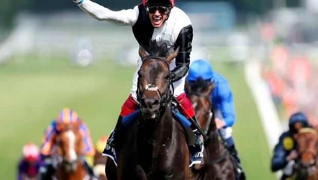 Frankie Dettori celebrates as Golden Horn passes the winning post clear of his Epsom Derby rivals