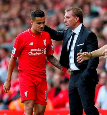 Liverpool manager Brendan Rodgers with Philippe Coutinho after he was sent off