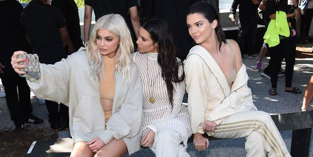 Kylie Jenner, Kim Kardashian, and Kendall Jenner attend the Kanye West Yeezy Season 4 fashion show on September 7, 2016 in New York City.  (Photo by Jamie McCarthy/Getty Images for Yeezy Season 4)