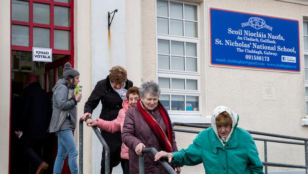 People leaving Scoil Nioclais Naofa, the Claddagh National School polling station in Galway, as people in Ireland vote in the 2020 Irish general election. Photo: Liam McBurney/PA Wire