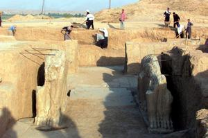 A file picture taken on July 17, 2001 shows Iraqi workers cleaning an archeological site in Nimrud