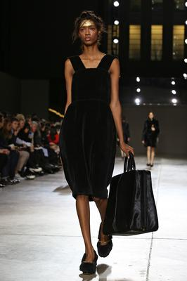 A model walks the runway at the Simone Rocha show at London Fashion Week AW14 at Tate Modern