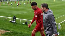 Dublin-born physio Richie Partridge is pictured with Alex Oxlade-Chamberlain during his time at Liverpool