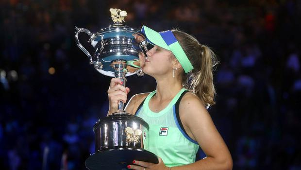Tennis - Australian Open - Women's Singles Final - Sofia Kenin of the U.S. celebrates as she kisses the trophy after winning her match against Spain's Garbine Muguruza REUTERS/Hannah Mckay