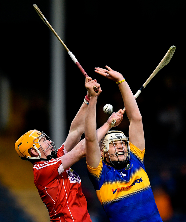Anthony McKelvey of Tipperary in action against James Keating of Cork. Photo: Sportsfile