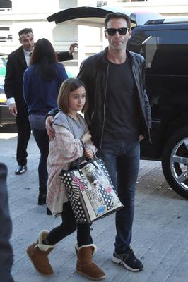Courteney Cox, Johnny McDaid, and daughter Coco Arquette are seen at LAX airport on February 14, 2014 in Los Angeles, California.  (Photo by GVK/Bauer-Griffin/GC Images)