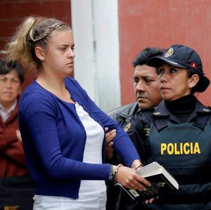 Melissa Reid (L), cuffed, is escorted from a truck to court at Sarita Colonia prison in Callao, October 1, 2013.